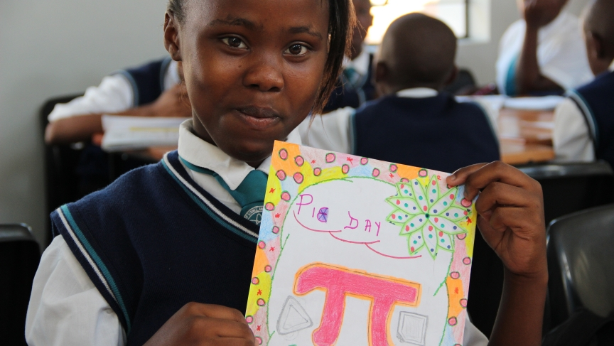 Zizipho, an 8th grade student, displays her Pi Day poster.