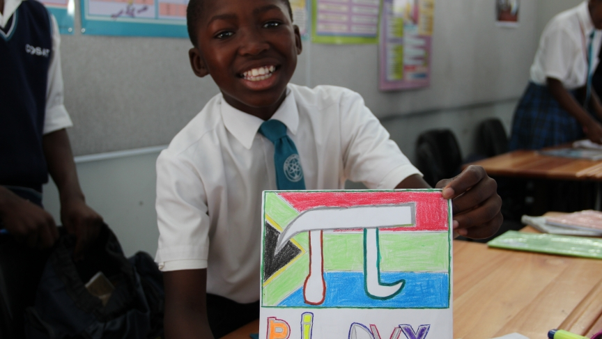 Buhle, an 8th grader, was rather proud of his Pi Day poster.