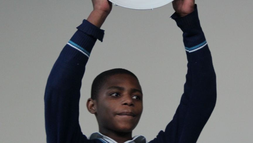 9th grader Nkosinathi Nkosia holds up his trophy -- a pie plate.