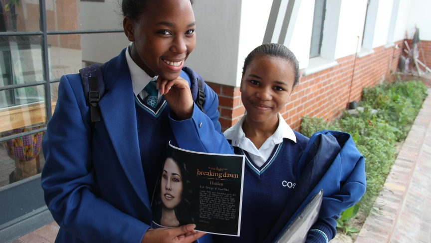 Ninth-graders Olwethu and Sisipho with a message from Huilen.