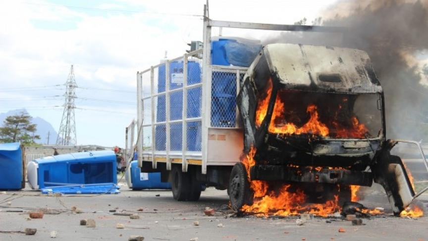 A burning truck blocks the road near Khayelitsha township.