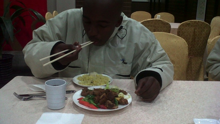 Monwabisi uses chopsticks successfully for the first time.