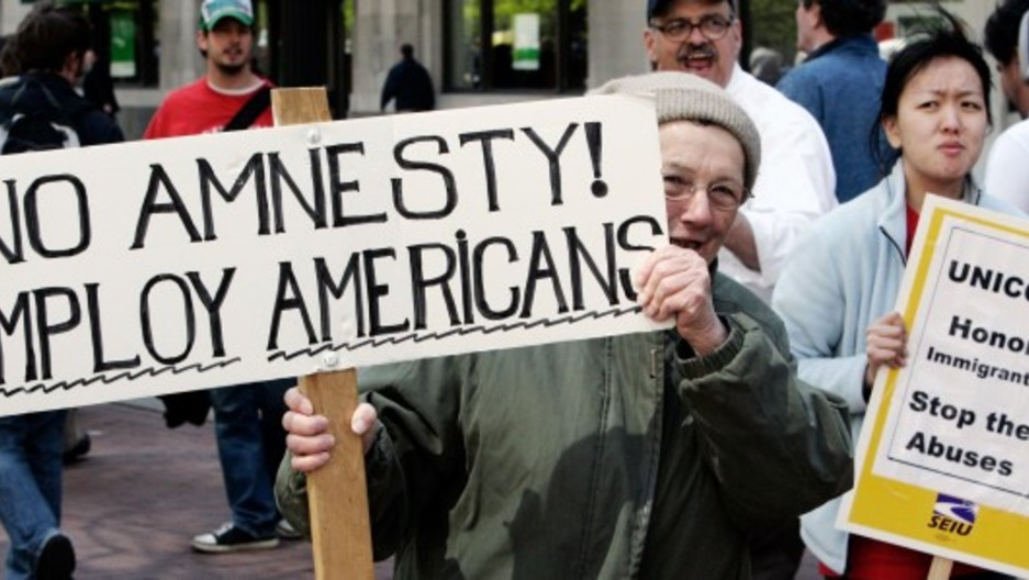 Mary Horrigan L Carries A Sign Against Amnesty For Illegal Immigrants At A Rally In Support Of Immigrants In Boston Mass May