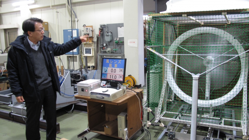 """Wind power researcher Uji Ohya demonstrates his """"wind lens"""" in a wind tunnel in his lab at Kyushu University in Fukuoka."""