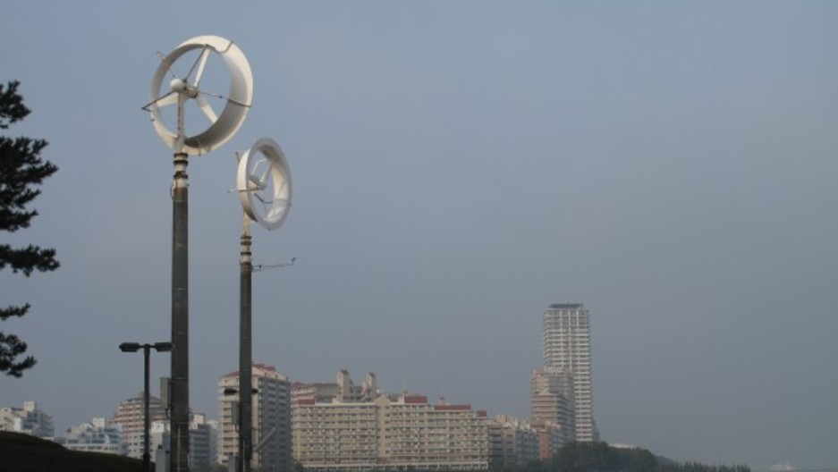 "Two experimental ""wind lenses"" rise over a park in Fukuoka, Japan."