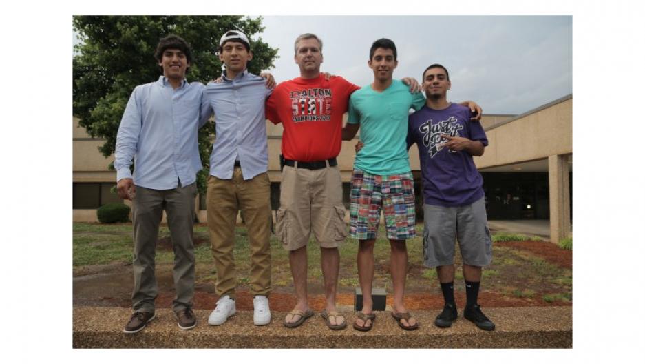 Coach Matt Cheaves stands with members of the Dalton High School soccer team in Dalton, Ga.