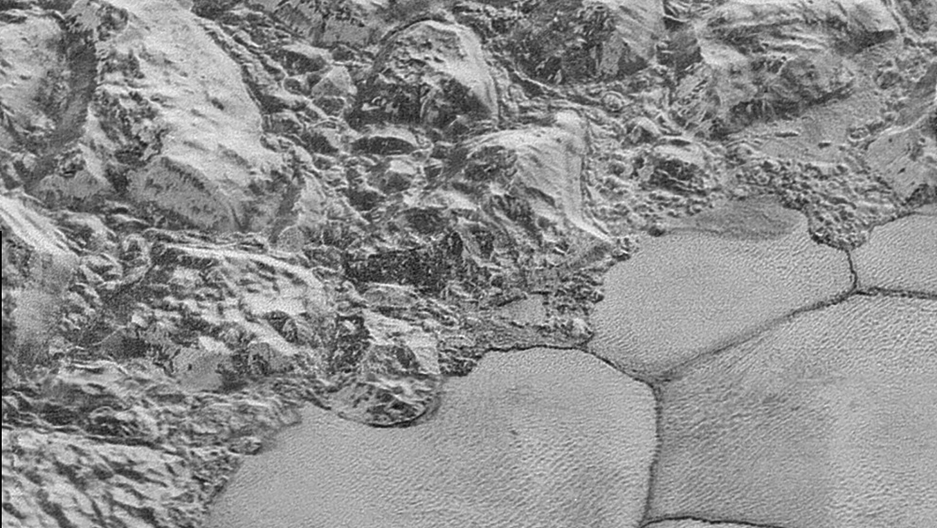 In this highest-resolution image from NASA's New Horizons spacecraft, great blocks of Pluto's water-ice crust appear jammed together in the informally named al-Idrisi mountains. Image by NASA/JHUAPL/SwRI
