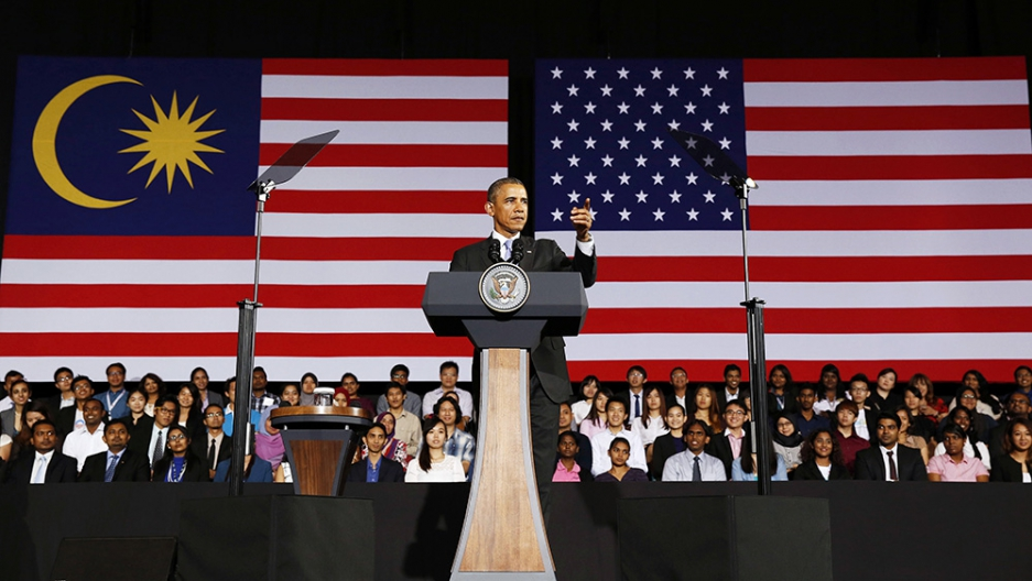 US President Barack Obama pauses after being introduced at the Young Southeast Asian Leaders Initiative Town Hall at University of Malaya in Kuala Lumpur April 27, 2014.  (PRI/Larry Downing)