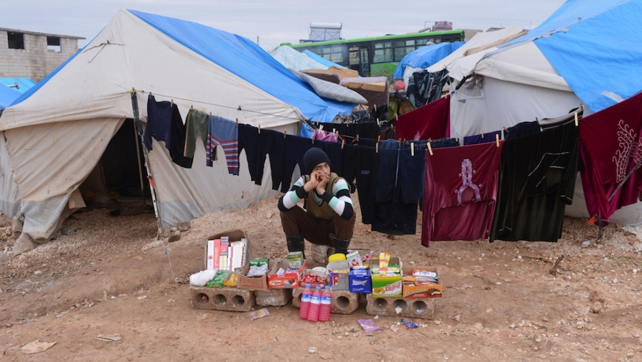 A displaced Syrian youth sells goods in front of his tent at the refugee c& of Qah along the Turkish border in the village of Atme on Feb. 7 2013. & Inflatable just-add-water concrete tent invented (VIDEO) | Public ...