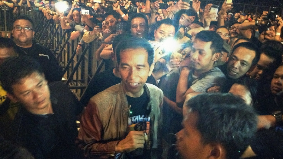 Meet jokowi metallica fan front runner for the indonesian jakarta governor joko widodo center in black t shirt and leather jacket is mobbed by rock fans as he arrived to watch a metallica concert at jakartas m4hsunfo