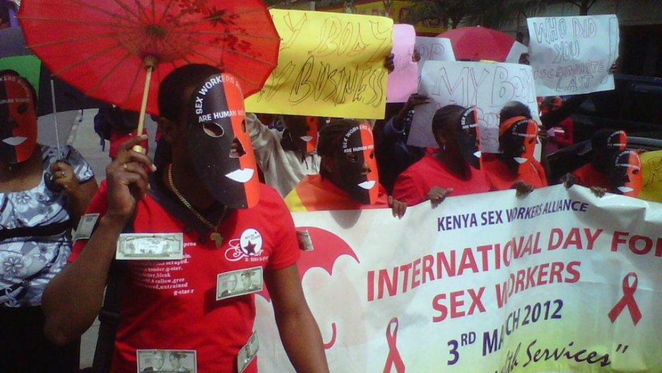 Kenyan Sex Workers March To Protest For The Legalization Of Prostitution On March 6 2012 In Nairobi Under Red Umbrellas And In Red T Shirts