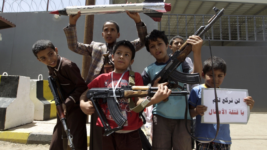 Yemeni children pose for a photo during a protest in front of the United Nations office in Sanaa on April 13, 2015 against a strike by the Saudi-led coalition the previous day.