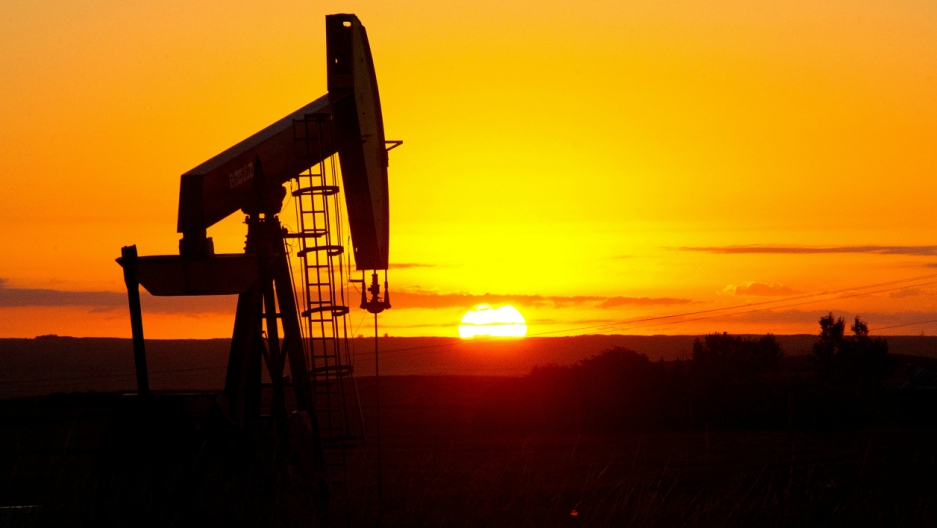 Oil drill sunset