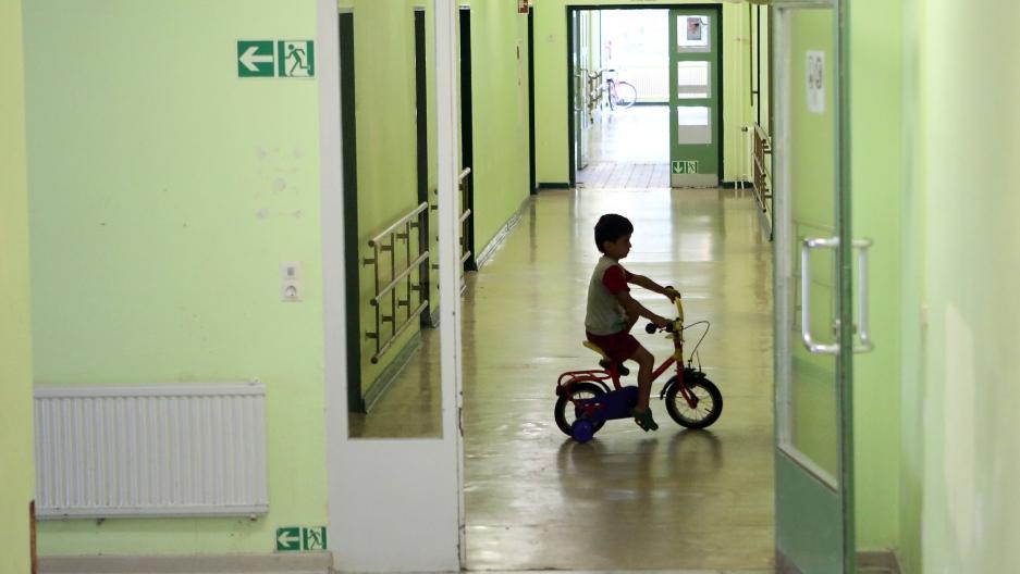 Refugee boy bicycle