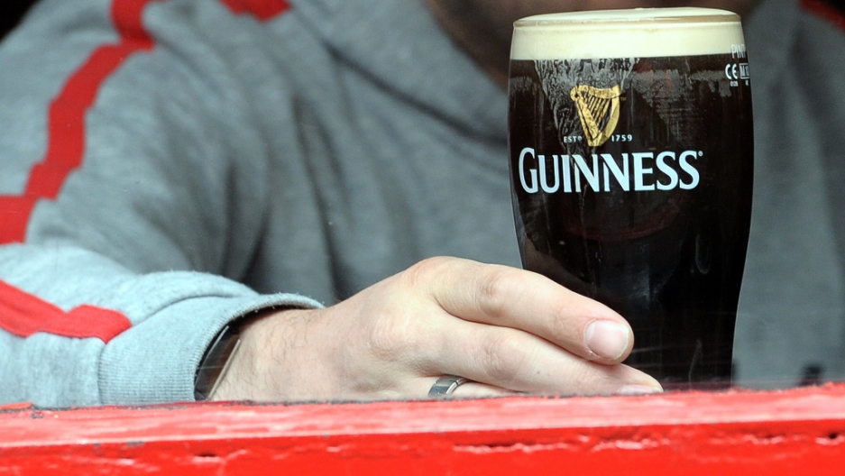 A man drinks a pint of Guinness in Dublin on May 20, 2011.