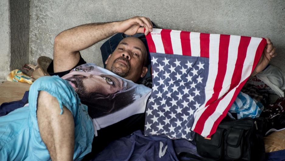 Cuban migrant shows US flag