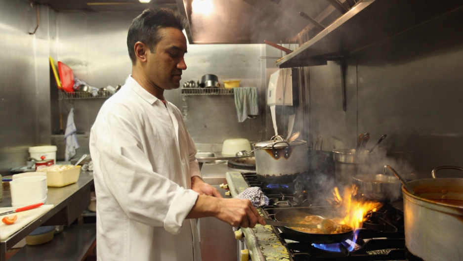 A chef cooks a lamb curry at Cafe Bangla curry house on Brick Lane in London on March 16, 2011.