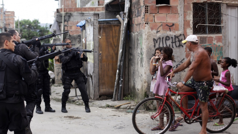Brazil police aim Rio favela