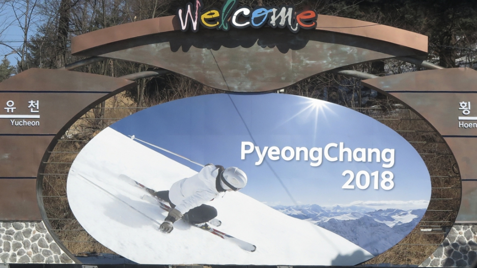 The advertising hoarding promoting the 2018 Winter Olympics stands in the mountain cluster of PyeongChang on Feb. 9, 2015.