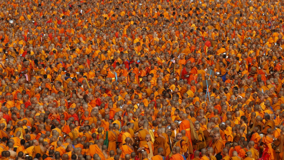 Devotees At Thai Temple Give Alms To Tens Of Thousands Of Buddhist