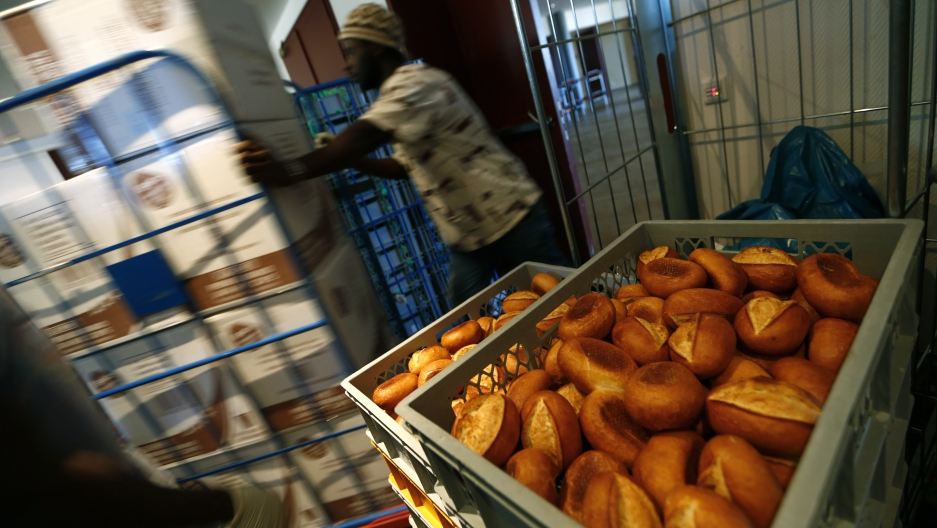 A migrant works in the food distribution area at the Patrick-Henry Village refugee center, a former U.S. military facility in Heidelberg, Germany September 29, 2015.