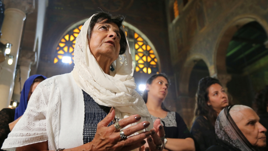Relatives of the Christian victims of the crashed EgyptAir flight MS804 attend an absentee funeral mass at the main Cathedral in Cairo, Egypt, May 22, 2016.