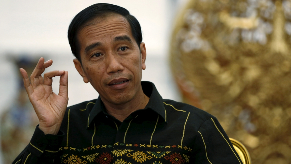 Indonesian President Joko Widodo gestures during an interview with Reuters at the Presidential Palace in Jakarta, Indonesia, February 10, 2016.