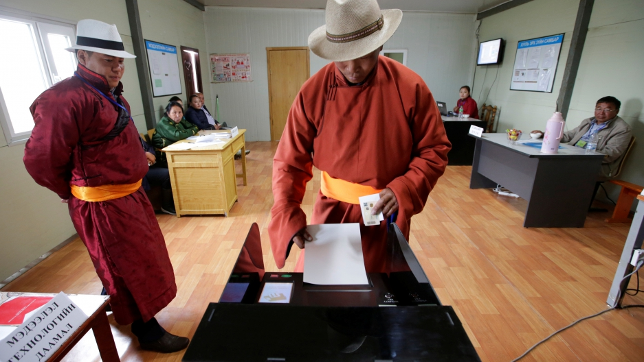 A villager casts his vote at a polling station on the outskirts of Ulaanbaatar, Mongolia, on June 29, 2016.