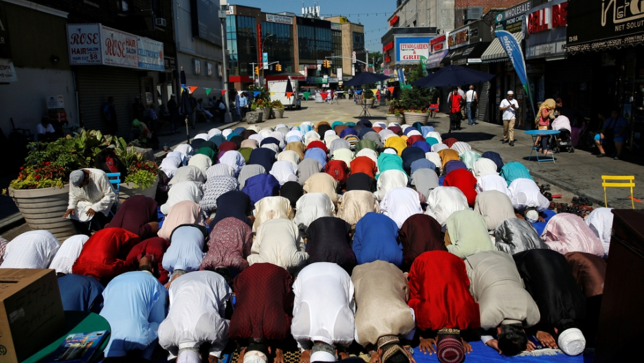 Muslim men attend Eid al-Fitr prayers to mark the end of the holy fasting month of Ramadan in the Queens borough of New York, U.S., July 6, 2016.