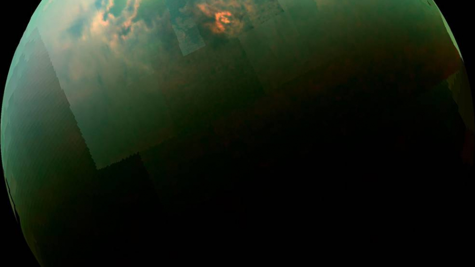 Sunlight glints off of Titan's northern seas in this near-infrared color mosaic from NASA's Cassini spacecraft. Credits: NASA/JPL/University of Arizona/Univeristy of Idaho