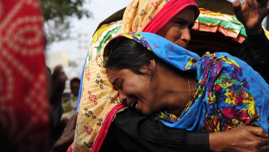 3ff773b7 A woman cries at the Hamim Group garment factory at Ashulia on December 15,  2010 as her husband died during the fire accident. A raging fire on  December 14, ...
