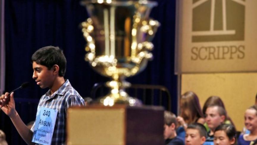 Ansun Sujoe, of Fort Worth, spells a word correctly behind the winner's trophy during the 2013 Scripps National Spelling Bee, May 29, 2013 (Photo: Reuters/Larry Downing)