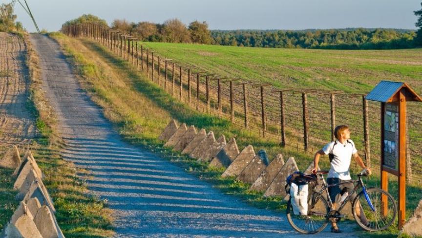 A rider checks a map along the Iron Curtain Trail.