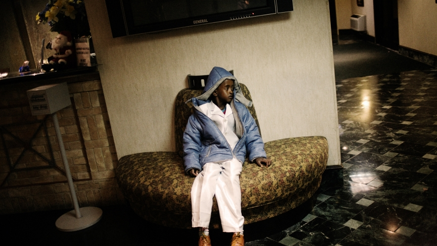 A Somali boy, a refugee, waits in a hotel lobby in Newark on December 11, 2009. He and his family would soon be assigned a room of their own and then begin their refugee resettlement process in the United States.
