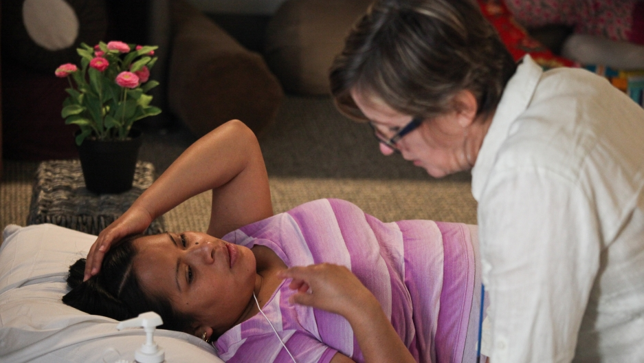 Laurie Jurkiewicz, a midwife at San Francisco General Hospital, consults a patient during a Centering Pregnancy session.