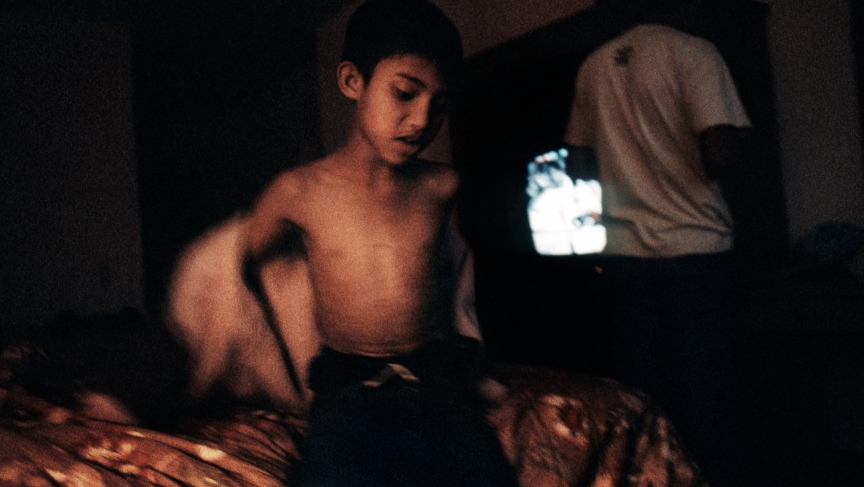 A young boy from Bhutan in a hotel room in Los Angeles, waiting to be transferred to his resettlement destination in 2008.