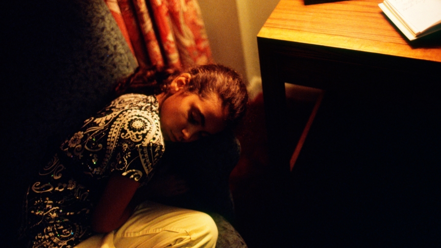 A Cuban girl, a refugee, asleep at a hotel in Miami on November 15, 2007. The brief hotel stay marked her first night in the United States.