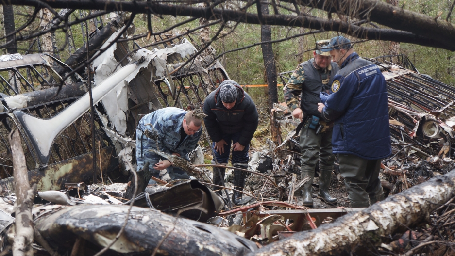 Examining the wreckage of the AN-2 that crashed in June 2012 near Serov, Russia. It took nearly a year to find the crash site.
