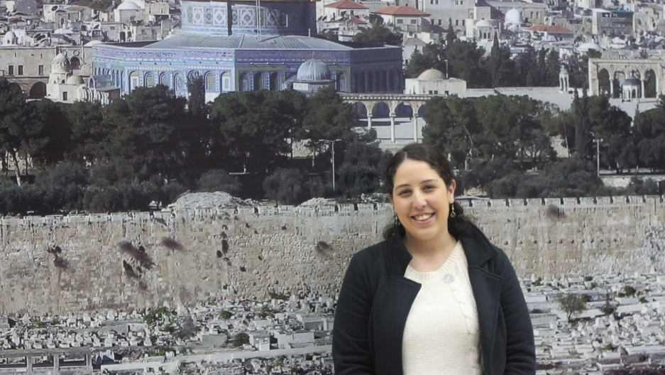 Liraz Yaffe, a political science student at Ben Gurion University, in front of a poster in the Palestinian government headquarters. Palestinian guards prevented many of the students from entering with their telephones, so a reporter took her photo for her