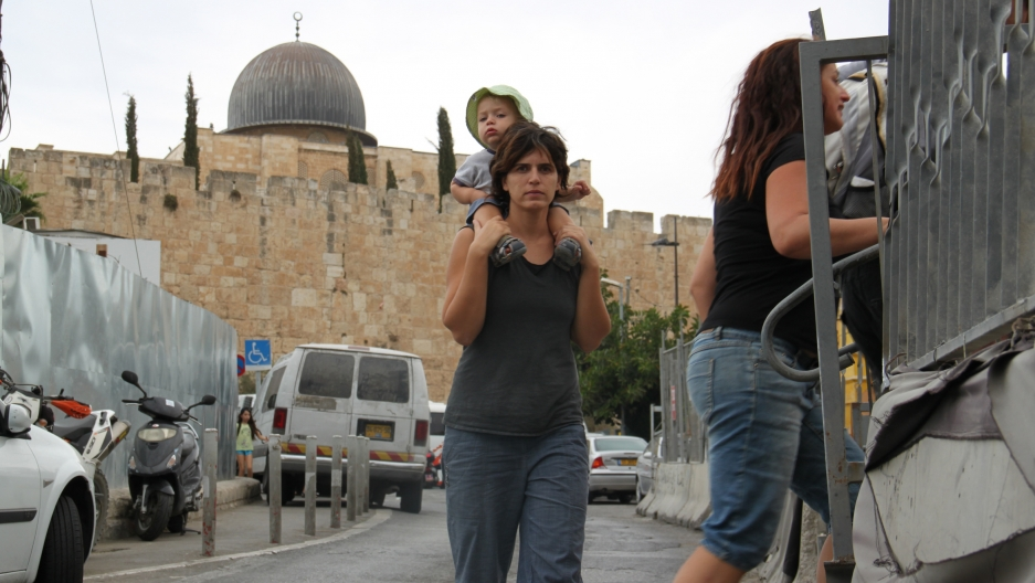 Visitors to the City of David, with the Al Aqsa mosque and the Old City walls nearby.