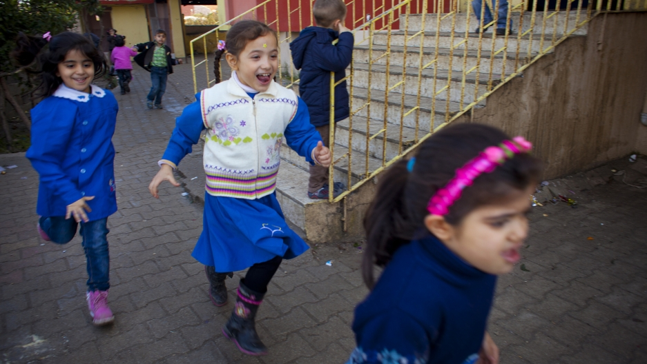 Children during recess at the Albashayer School for Syrian Refugee Children, where many seem enthusiastic about being back in school.