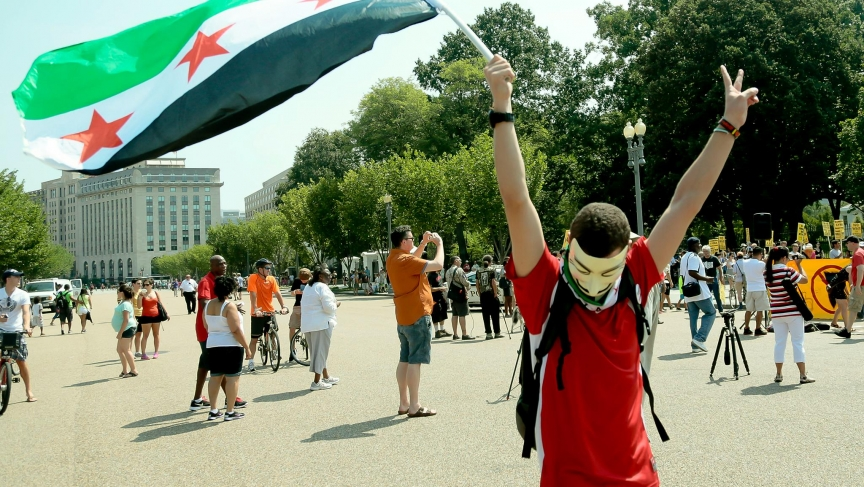 Fouad Faris carries a Free Syrian Army flag at a protest in Washington, D.C. against the Syrian military's use of chemical weapons.