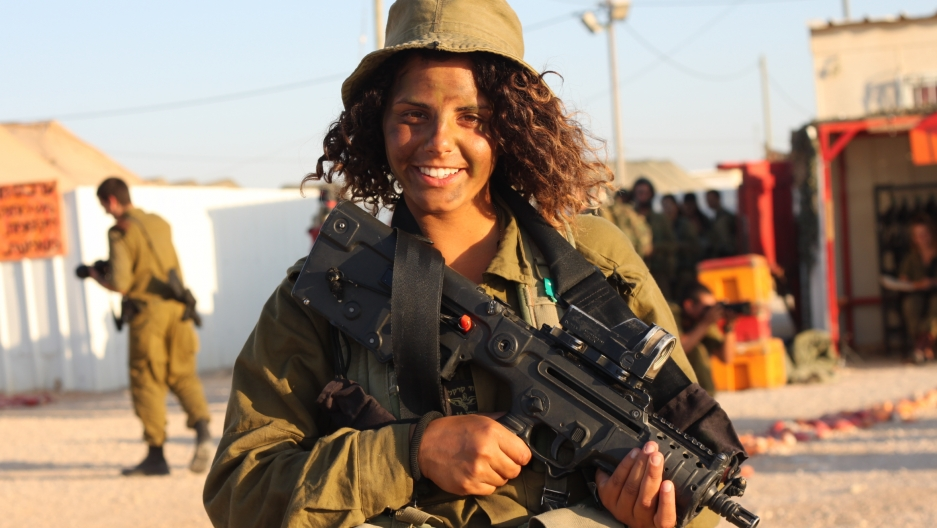 An Israeli soldier in the mostly-female Caracal combat unit of the Israeli army poses for the camera.