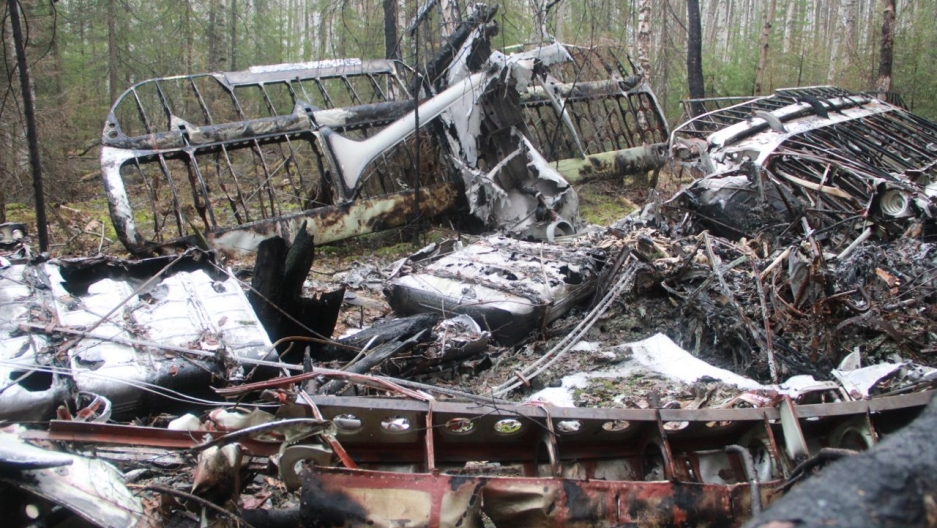 The plane's wreckage was found nearly a year after it crashed in a swamp in the woods.