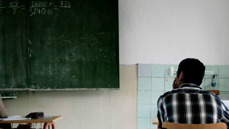 16-year old Faro Duzdova sits in the front row in his new, mixed ninth-grade math class at Šarišské Michaľany.