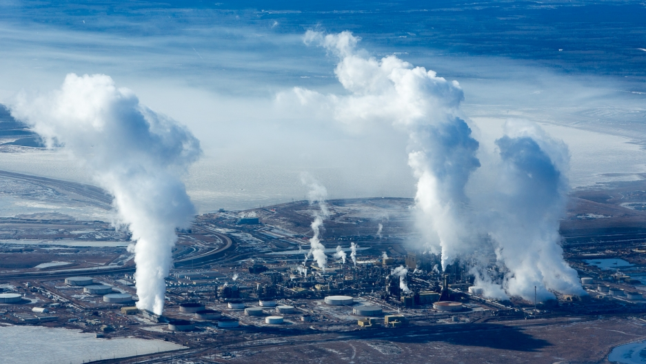 Rising steam and smoke at the Syncrude Mildred Lake upgrade refinery.