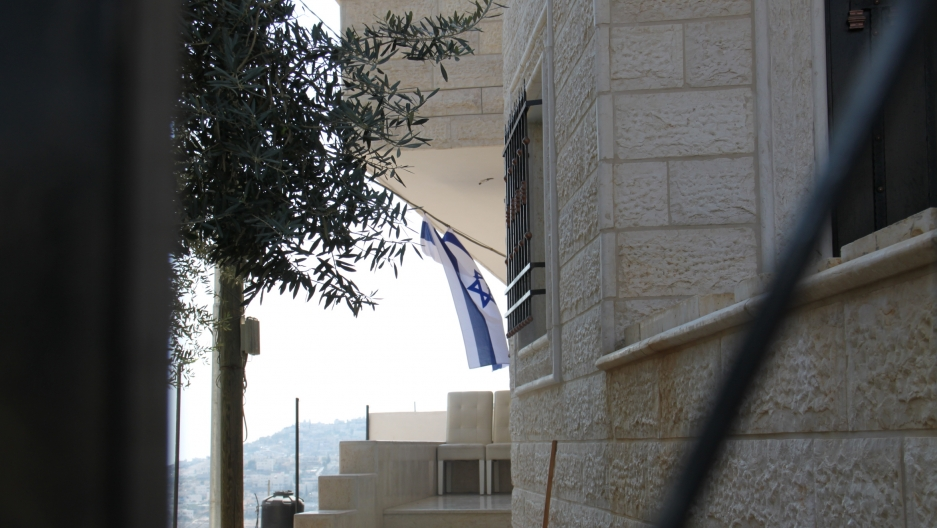 The Baydoun property was occupied by armed Israeli guards, residents say, and an Israeli flag was affixed.