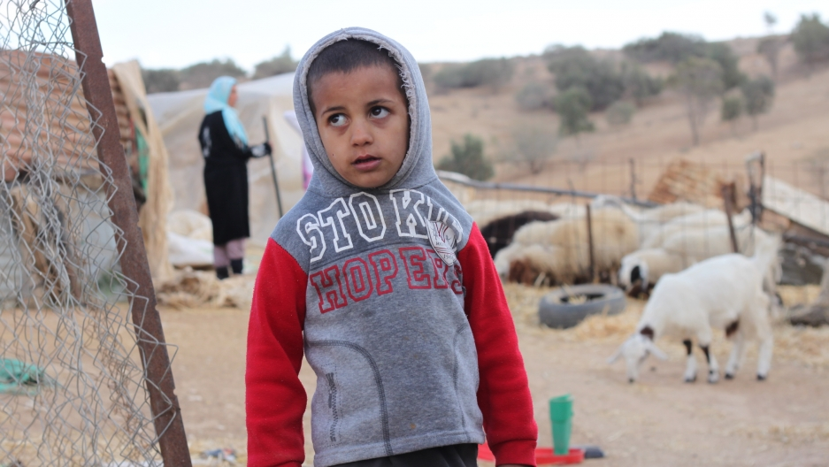 Child in the extended Abu Al Giyan family