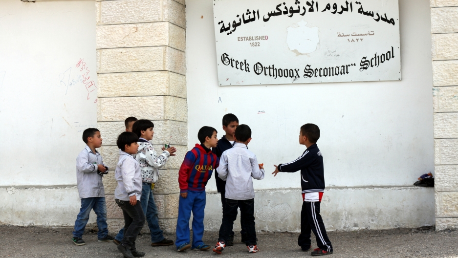 Kids playing outside the Greek Orthodox Secondary School, which hosts kindergarten through high school students, in Taybeh, West Bank.