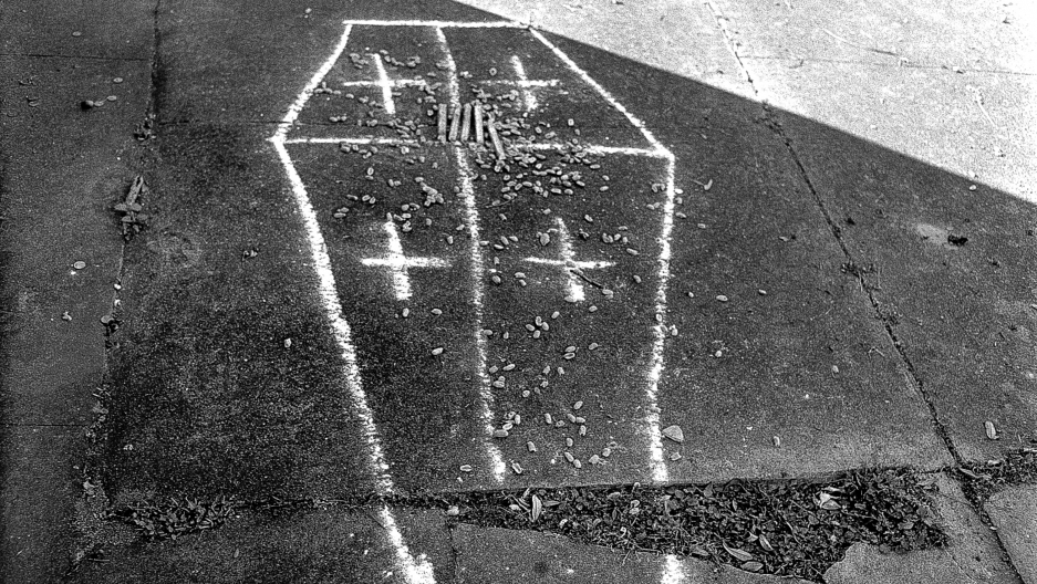 Voodoo ritual with cigars and chalk drawing of a casket in a cemetery in New Orleans, Louisiana, 1997